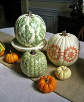 stenciled bright pumpkins are great for the fall, and such a DIY is very easy to make yourself