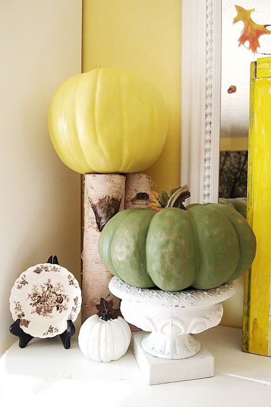 natural pumpkins painted in bright colors are lovely for decorating for the fall, enjoy super bright shades