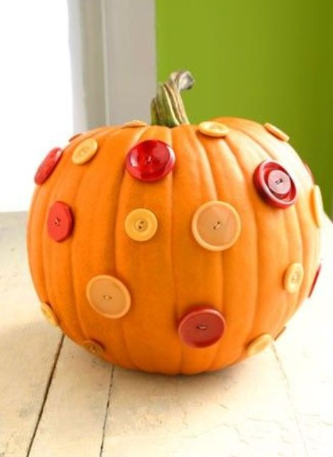 a natural pumpkin covered with bright buttons is a lovely and bold decoration for the fall, DIY it fast