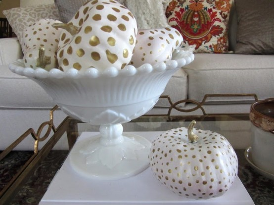 an arrangement of painted white and gold polka dot min pumpkins is a lovely idea to decorate your home for the fall