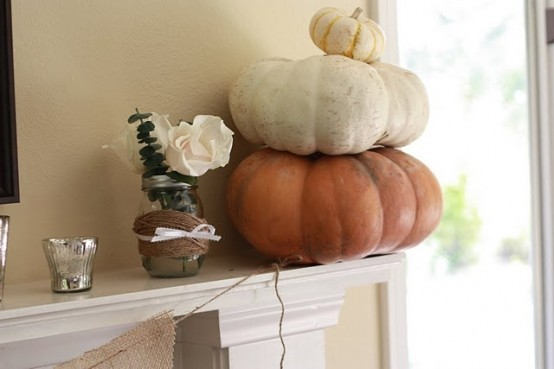 a stack of natural pumpkins is a cool fall decoration for a mantel, table, console or some other space