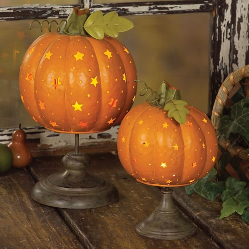pumpkins with cutout and painted stars on stands will make your fall home look dreamy and romantic