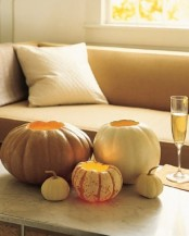 cutout pumpkins with candles are nice lanterns and centerpieces or decorations you can easily make