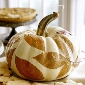 pumpkins with decoupaged fall laves are amazing for decorating your home for the fall