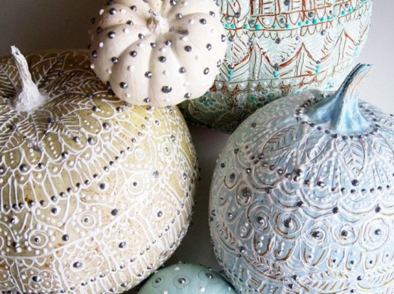 pastel and neutral pumpkins decorated with beautiful paint patterns and silver beads are a very delicate and chic idea for fall or Halloween decor