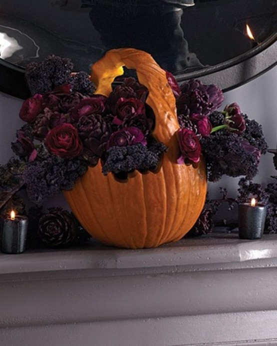 a pumpkin carved and filled with dark blooms is a very stylish and decadent decor idea for Halloween and it looks fantastic