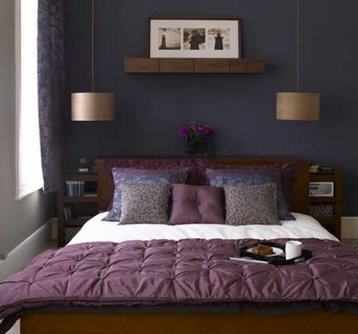 a purple accent wall, a purple floral curtain, wooden furniture, purple and leopard print bedding and chic pendant lamps