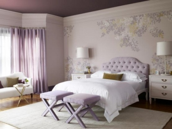 a romantic girlish bedroom with a purple ceiling, floral walls, a lavender bed and stools, curtains, mustard touches