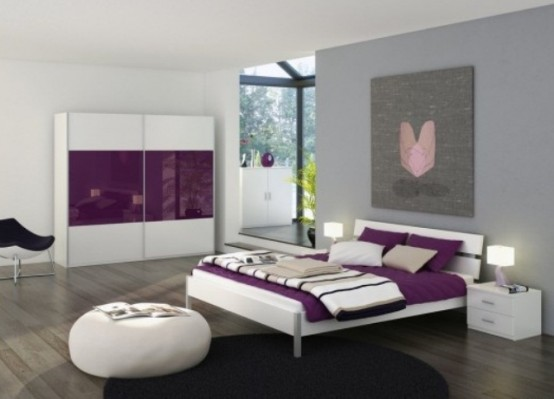 a white and purple bedroom with sleek minimalist furniture, a statement artwork, purple and white bedding and table lamps