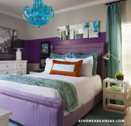a colorful bedroom with a color block purple and white wall, a purple bed and touches of turquoise and aqua is very fun and bold