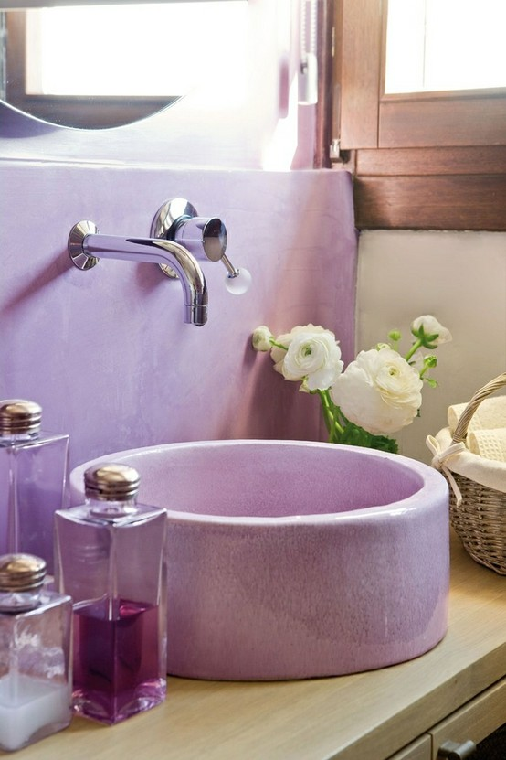 a chic bathroom nook with a lavender round sink and backsplash and contemporary hardware looks very girlish and cute