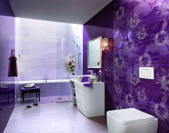 a super bright purple and lavender bathroom clad with various types of tiles including floral ones, elegant lighting and sculptural vanities