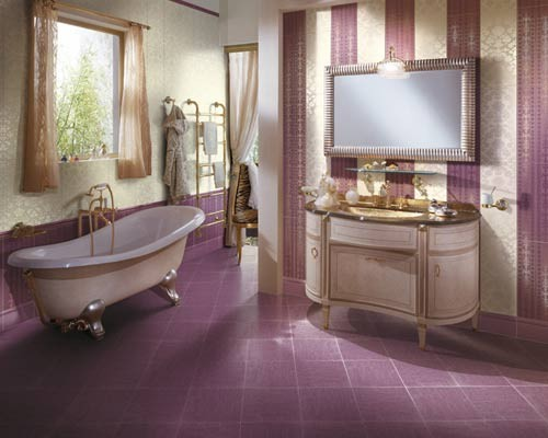 a cheerful retro-inspired purple and neutral bathroom with a striped wall, a purple tile floor and a vintage clawfoot bathtub plus curtains