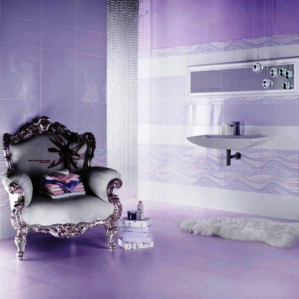 a whimsical purple bathroom with an elegant vintage chair, a beaded curtain, bubble pendant lamps and a floating sink