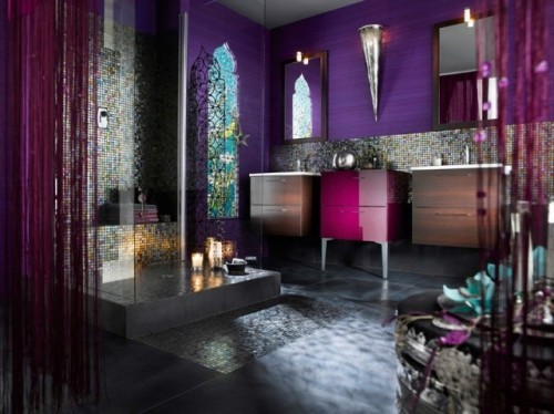 a bright purple bathroom with purple wallpaper, fuchsia touches and bright tiles in the shower space