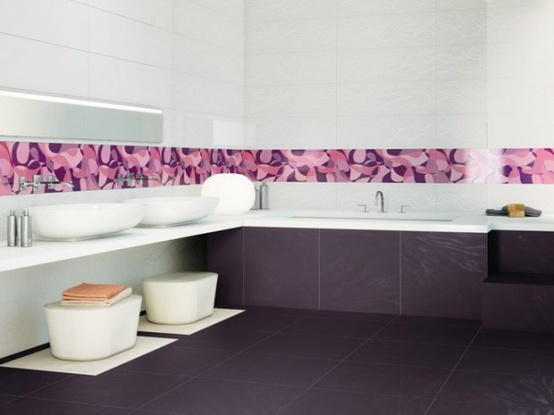 a bright contemporary bathroom with a deep purple tile floor, a colorful edge and white appliances