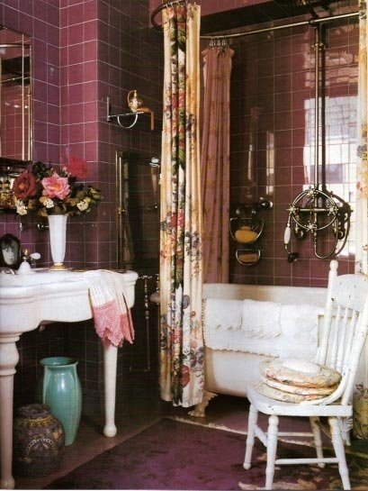 a shabby chic bathroom done in chocolate brown, purple and whites, floral textiles and a white vintage table