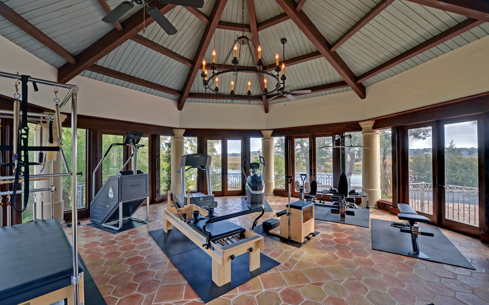 quite functional sunroom gym with a bunch of cool exercise machines
