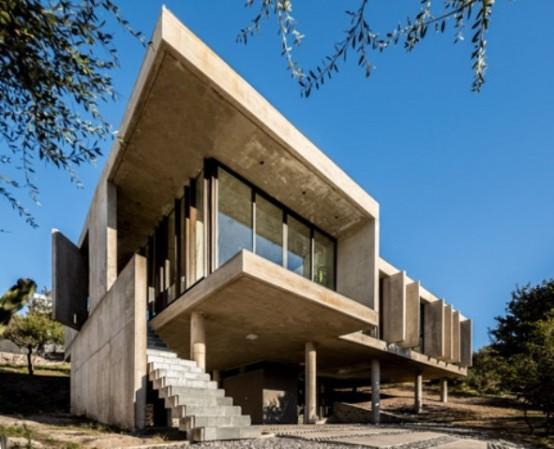 raw concrete house in la rufina elevated above the