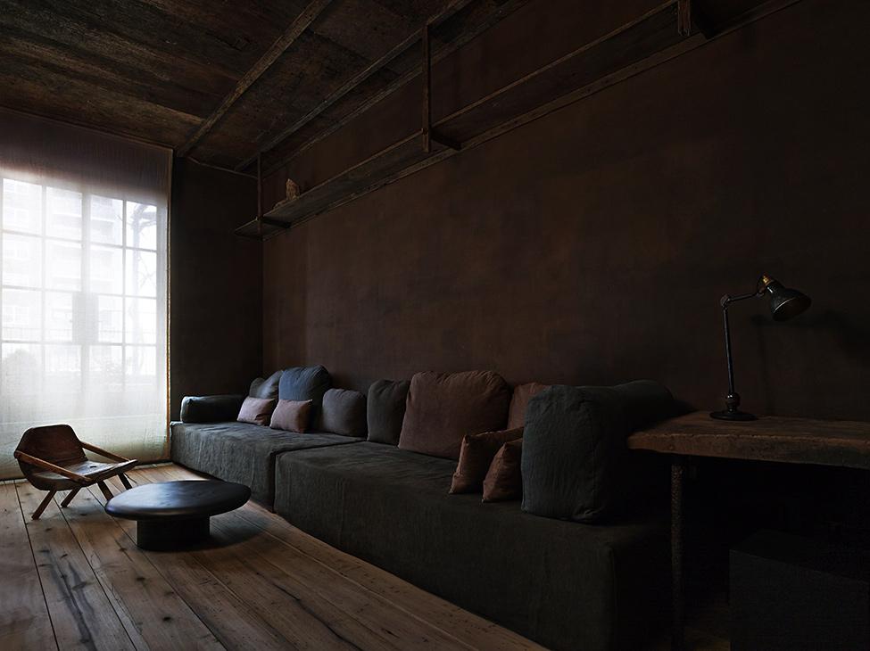 Raw Industrial Penthouse In Dark Earthy Shades
