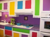 a colorful ktichen with bold panels and a purple countertop is a lovely idea done with much fun and whimsy
