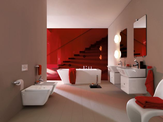 a red and white bathroom in contemporary style, with a statement red wall and red textiles and all white everything