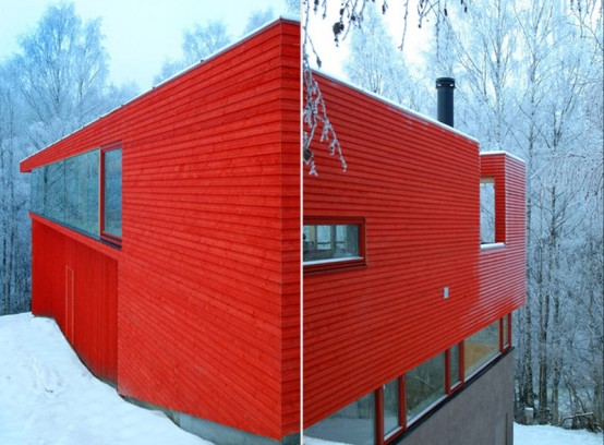 Red Wooden House In Snowy Area