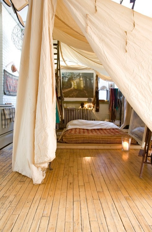 Nothing says boho like sleeping on a floor surrounded by a large canopy.
