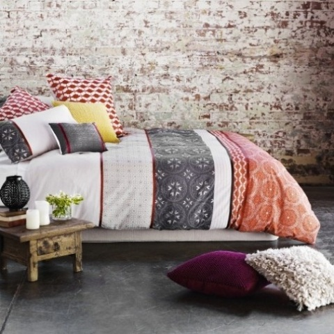 Whitewashed brick is a great background for a stylish boho bedroom.