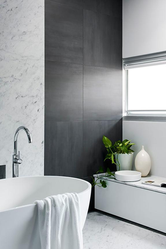 Refined yet minimalist bathroom design with greenery for Award winning small bathroom designs