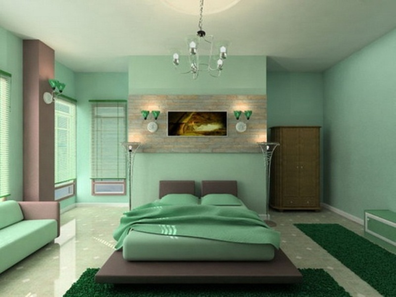 a green zen bedroom with brown touches, a platform bed, a green sofa, a wardrobe and a bench plus lights is a lovely idea