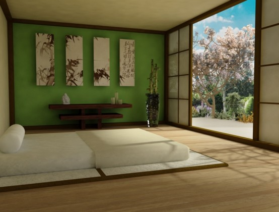 a zen Asian bedroom with a green accent wall, a bed on the floor, a gallery wall with bamboo and a console table of dark wood is a lovely idea