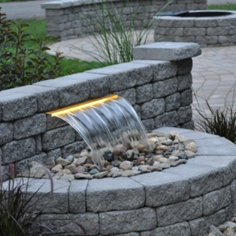 Contemporary waterfalls looks great too. Besides they could fit your backyard's landscape even better than natural ones.