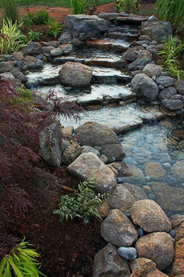 63 relaxing garden and backyard waterfalls digsdigs for Stone garden waterfall