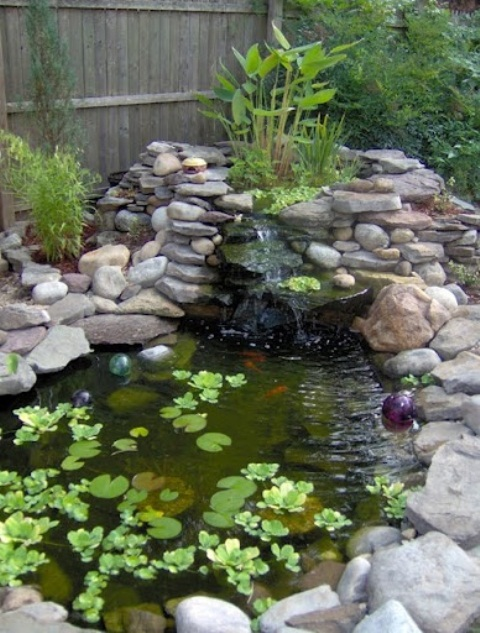 75 relaxing garden and backyard waterfalls digsdigs for Decoration jardin palmier