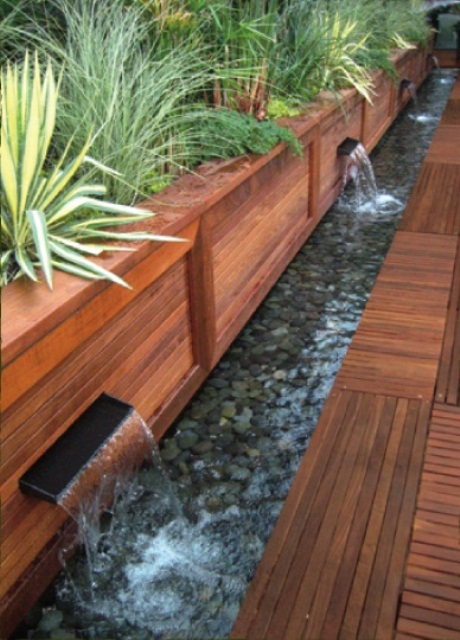 This awesome contemporary waterfall idea could be used to edge your terrace or patio.
