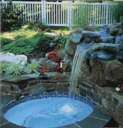A waterfall is a great addition even to a small pool.