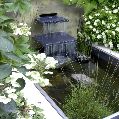 Contemporary waterfall would make even a small pond  shine.