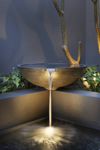 Stone bowls are perfect for modern backyard waterfalls.