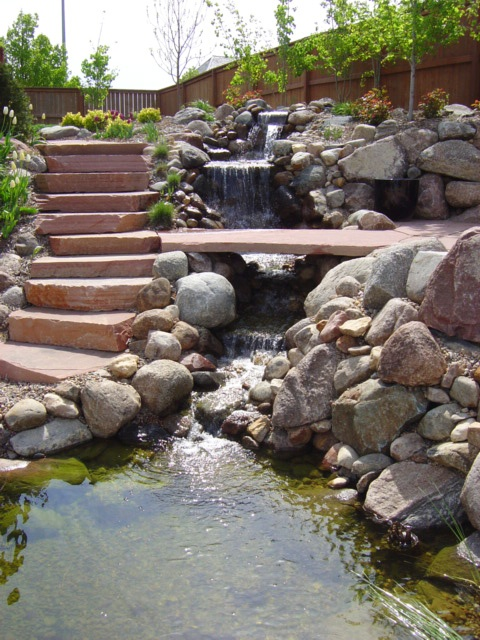 If your backyard is located on sloping slope then it's really logical to build a waterfall there.