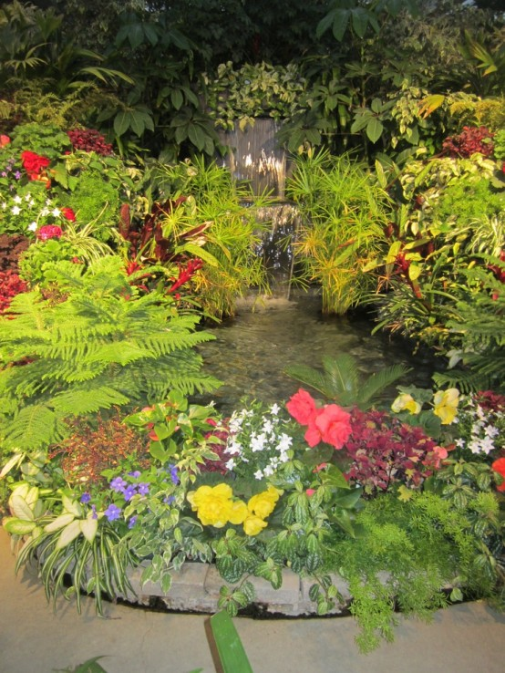 Surround your garden waterfall with flowers and it'd look like it was there before your house.