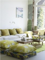 a neutral space done with mustard touches and low tables plus Moroccan tea pots