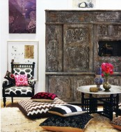a neutral Moroccan living room with a stunning carved storage unit plsu colorful pillows