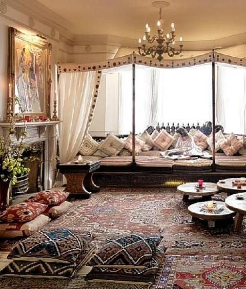 a welcoming Moroccan living room with lots of color and pattern, with low tables and pendant lamps