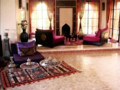 a bright Moroccan living room with colorful furniture, curtains and low tables, with traditional teaware