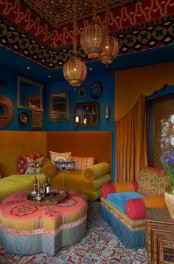 a super bright Moroccan living room with all things Morocco, adorable lanterns and upholstered furniture