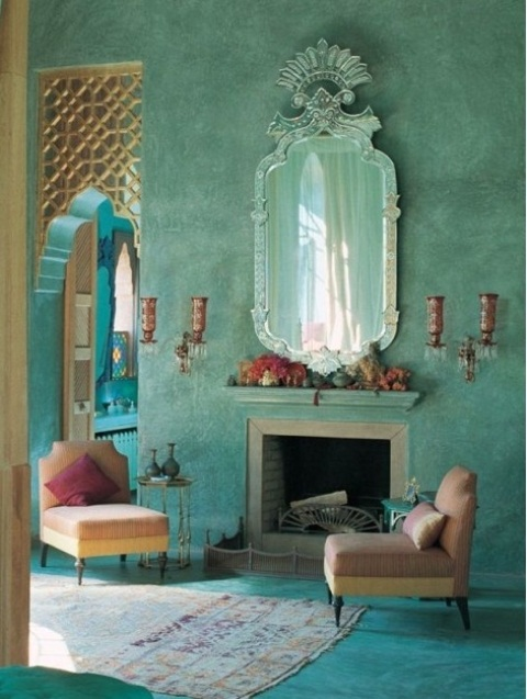 a bold aqua living room with wall lamps and a mirror in a unique frame for a Moroccan feel