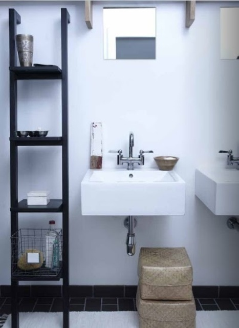 a black and white bathroom with two sinks, a large open storage unit and boxes for storage