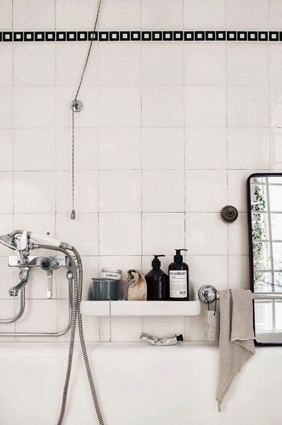 an off-white Scandinavian bathroom can be accented with black and vitnage appliances and faucets