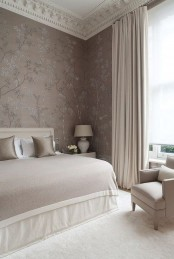 a girlish and soft bedroom done in a neutral and pastel color palette, with mauve walls, neutral furniture, chic lamps and neutral textiles